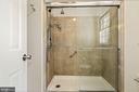 Master shower with frameless glass doors - 7808 CHARLESTON DR, BETHESDA