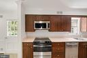 Kitchen with stainless steel appliances - 7808 CHARLESTON DR, BETHESDA