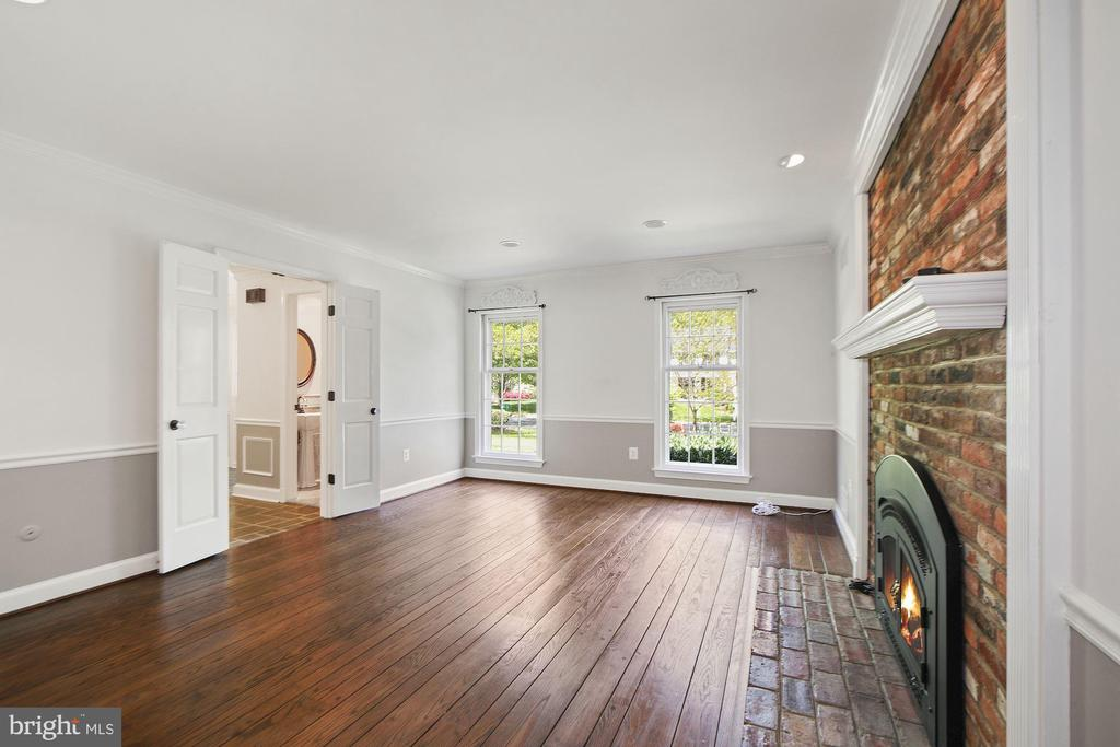 Cozy family room with brick fireplace - 7808 CHARLESTON DR, BETHESDA