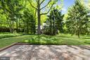Rear patio, perfect for entertaining outdoors - 7808 CHARLESTON DR, BETHESDA