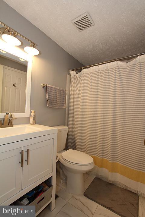 Renovated upper level full bathroom - 1594 WOODCREST DR, RESTON