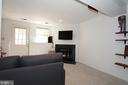 Lower level rec room with wood burning fireplace - 1594 WOODCREST DR, RESTON