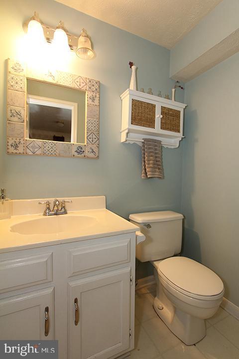 New vanity,toilet and tile flooring in full bath - 1594 WOODCREST DR, RESTON
