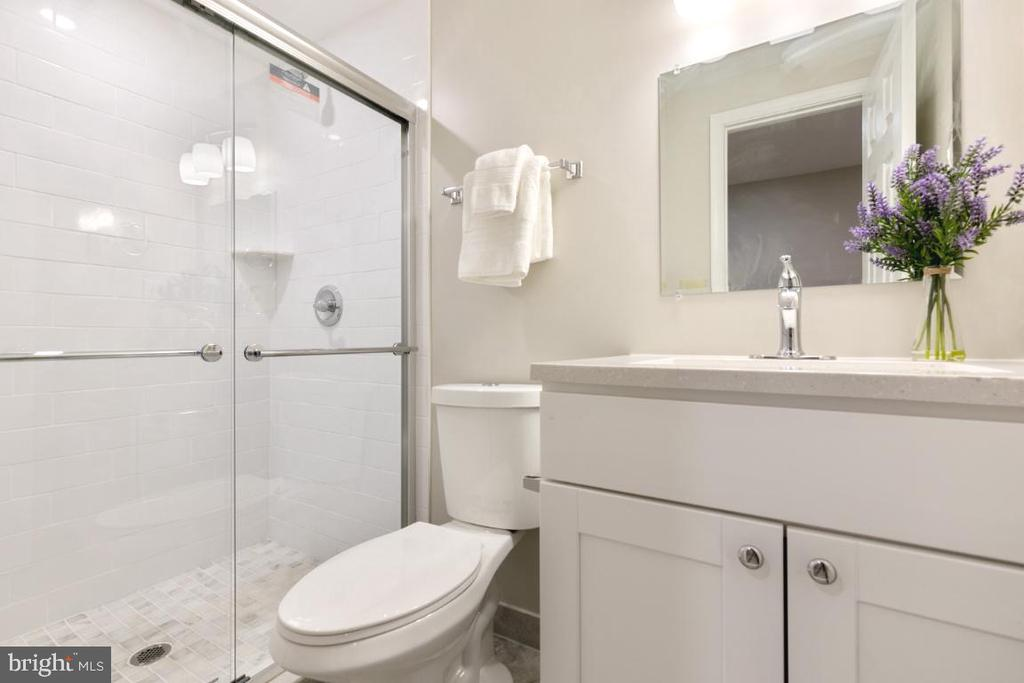 Lower level New Full Bathroom with Large Shower - 7307 TREETOP HILL LN, SPRINGFIELD