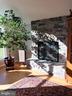 Great Room Stone Wood burning Fireplace - 11629 DUTCHMANS CREEK RD, LOVETTSVILLE