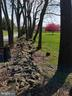 Stacked Stone wall- lining front yard by street - 11629 DUTCHMANS CREEK RD, LOVETTSVILLE