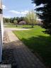 Side paving stone walkway toward front of house - 11629 DUTCHMANS CREEK RD, LOVETTSVILLE