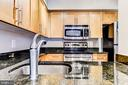 Open Kitchen with views to LR/DR - 7500 WOODMONT AVE #S902, BETHESDA