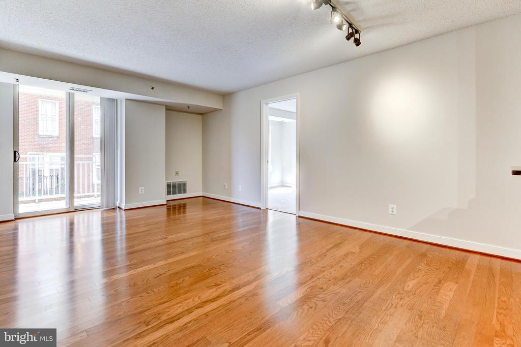 Living Dining Room with access to balcony - 7500 WOODMONT AVE #S902, BETHESDA