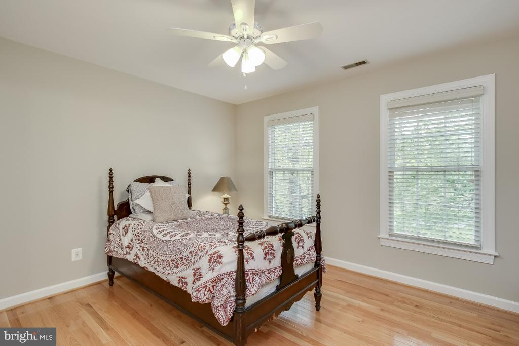 Bedroom 3 with hardwood flooring - 16917 OLD SAWMILL RD, WOODBINE