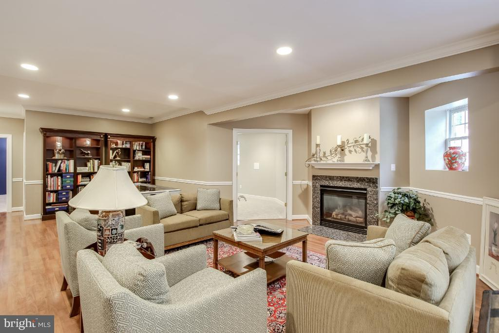 Family room replete w/ gas fireplace - 16917 OLD SAWMILL RD, WOODBINE