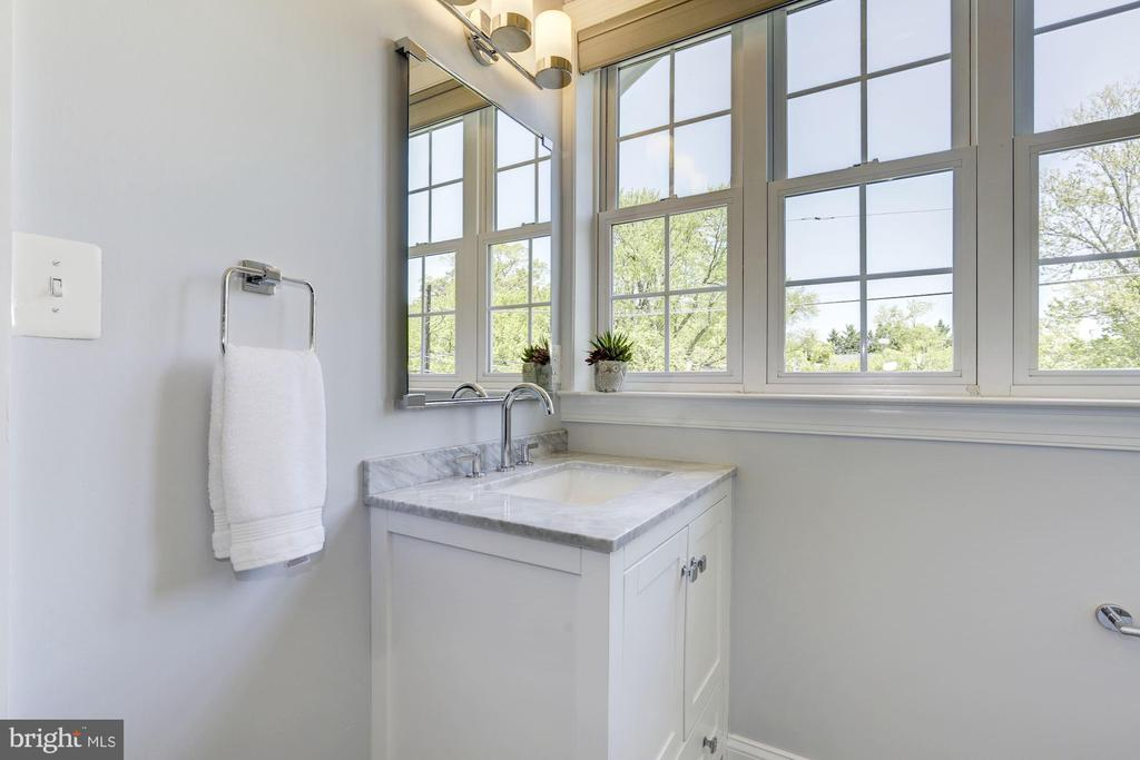 Newly renovated bathroom with door to Bedroom #4 - 5900 RYLAND DR, BETHESDA