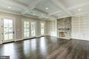 Family Room with Fireplace and Built-in Storage - 3201 WINNETT RD, CHEVY CHASE
