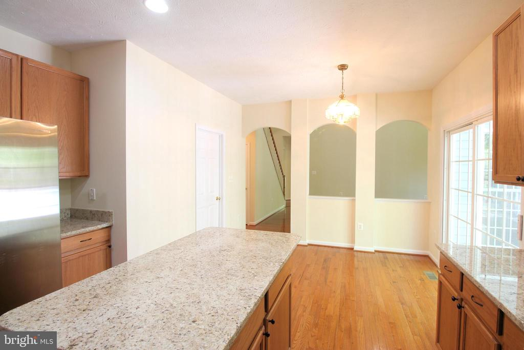 View from Kitchen into Living/Great Room - 612 LAKEVIEW PKWY, LOCUST GROVE