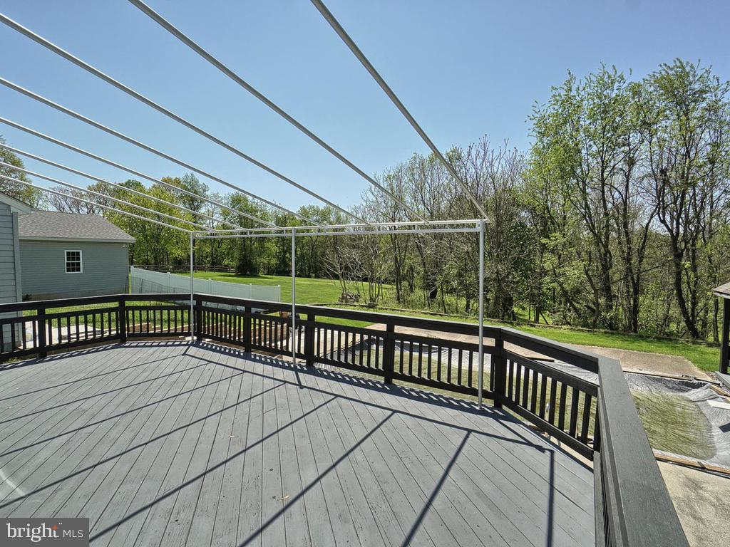 Large deck off Kitchen overlooks pool and backyard - 11667 FAIRMONT PL, IJAMSVILLE