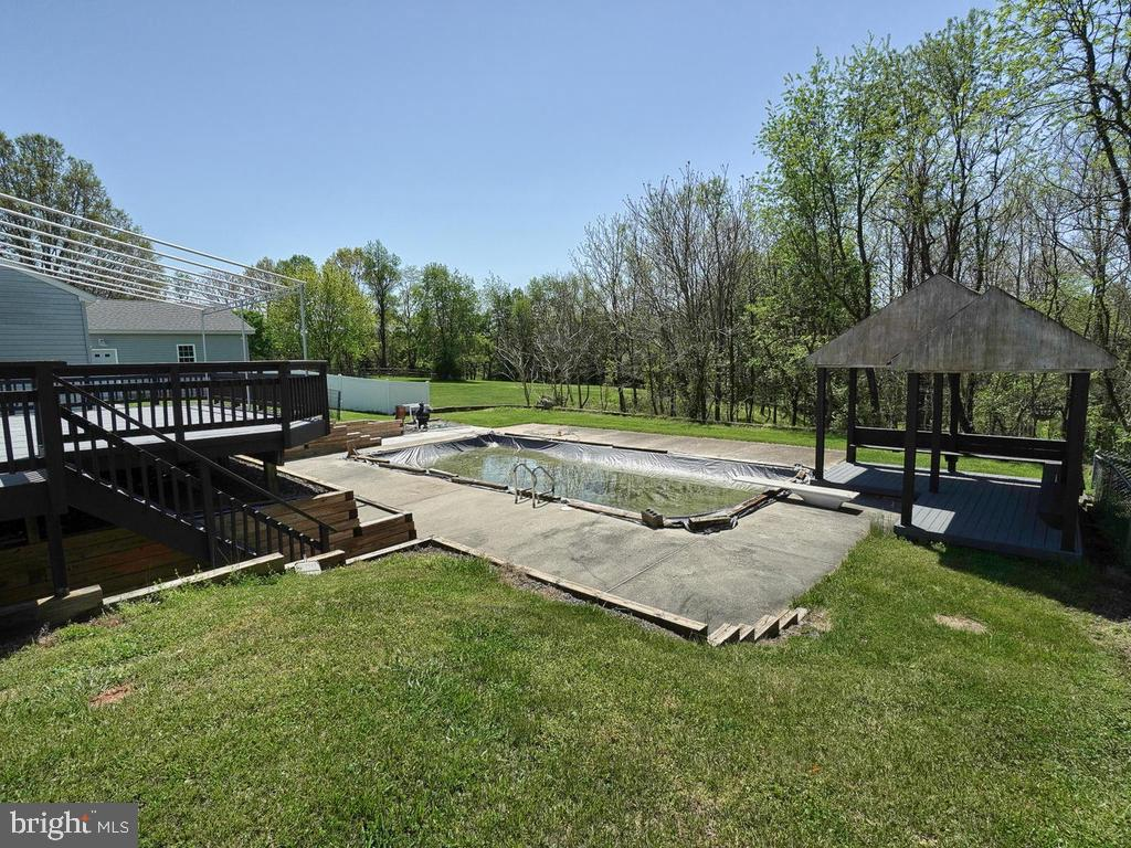 Inground concrete pool with diving board & gazebo - 11667 FAIRMONT PL, IJAMSVILLE