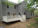 Rear View of House with Maintenance Free Deck - 612 LAKEVIEW PKWY, LOCUST GROVE