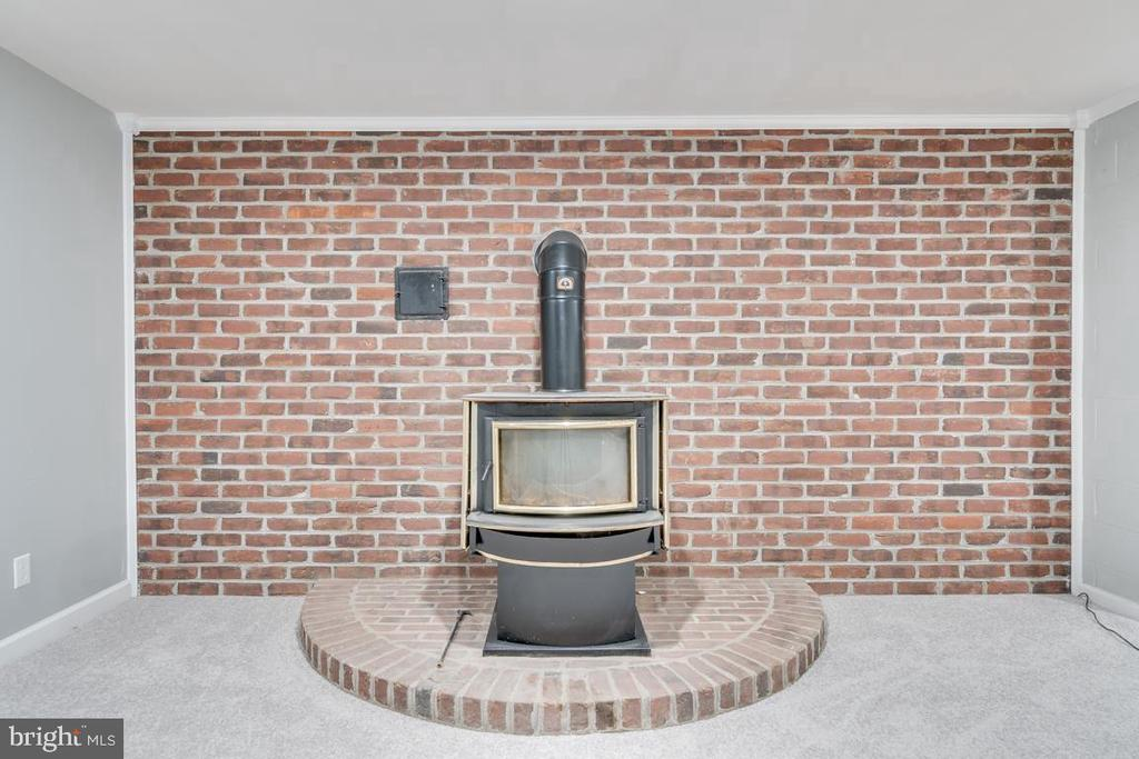 Wood Stove with Brick Surround - 646 HOLLY CORNER RD, FREDERICKSBURG