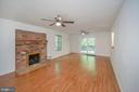 Brick fireplace & gas logs accent  Great Room - 118 INDEPENDENCE ST, LOCUST GROVE