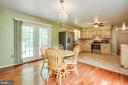 open-concept kitchen and dining area - 9521 RAPIDAN DR, FREDERICKSBURG