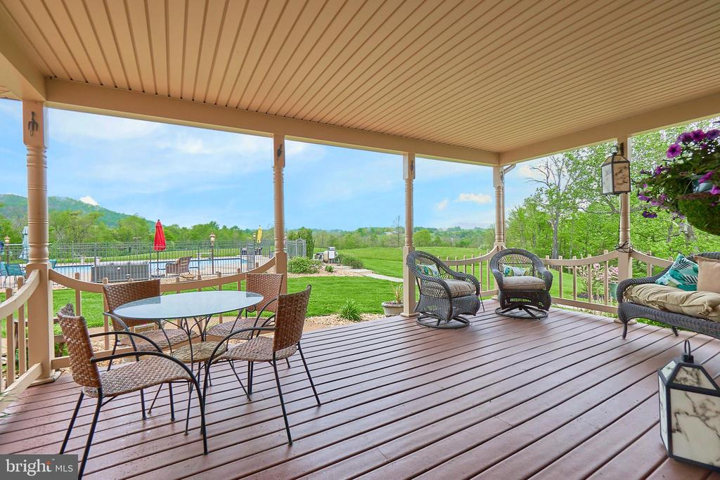 Covered porch overlooking mountains and pool yard - 345 GRIMSLEY RD, FLINT HILL