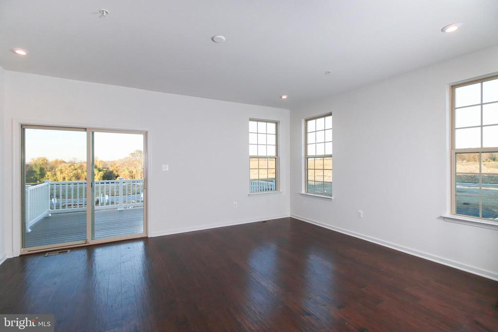 Family Room opens to large deck - 8479 BALD EAGLE LN, FREDERICK