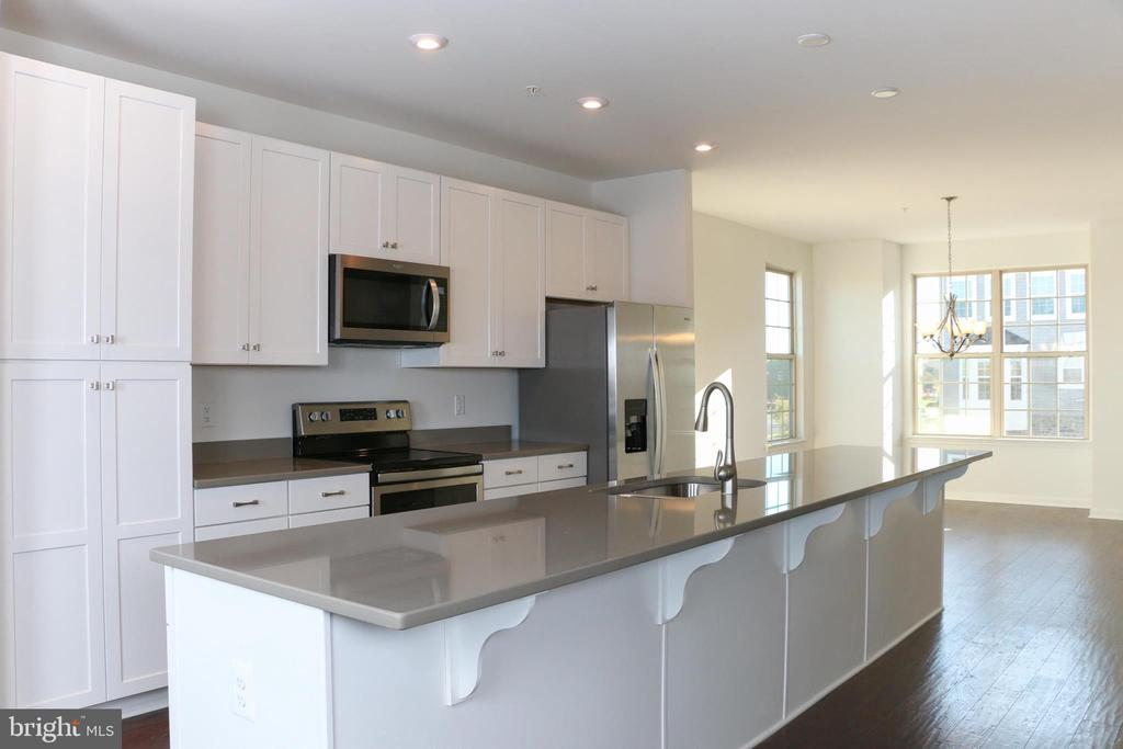 Open floor plan showing main level kitchen - 8479 BALD EAGLE LN, FREDERICK