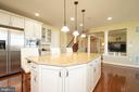 Kitchen Island with pendant lights - 42422 CHAMOIS CT, STERLING