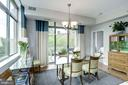 Formal dining area with access to private balcony - 1000 N RANDOLPH ST #310, ARLINGTON