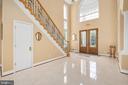 GLEAMING TILE FLOORS IN THE WELCOMING FOYER - 11010 SHERIDAN DR, SPOTSYLVANIA