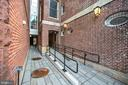 The brick covered walkway to its  private entry - 1745 N ST NW #103, WASHINGTON