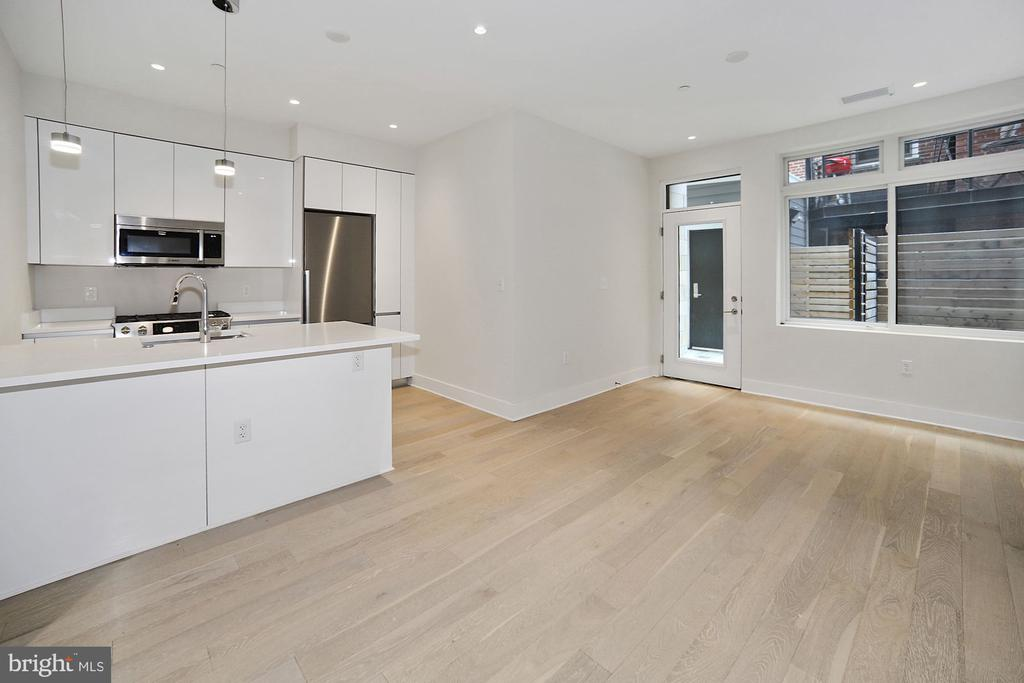 Open floor plan.  Breakfast bar. - 1745 N ST NW #103, WASHINGTON