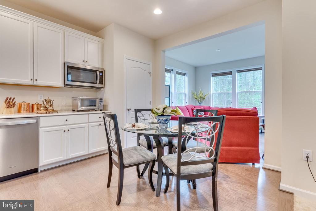 Beyond the breakfast nook is the family room - 440 FLIGHT O ARROWS WAY, MARTINSBURG