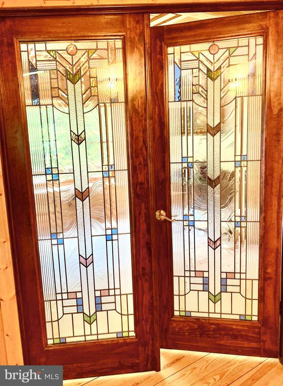 Double stained glass doors to 1st bedroom - 33150 HUMMINGBIRD LN, LOCUST GROVE