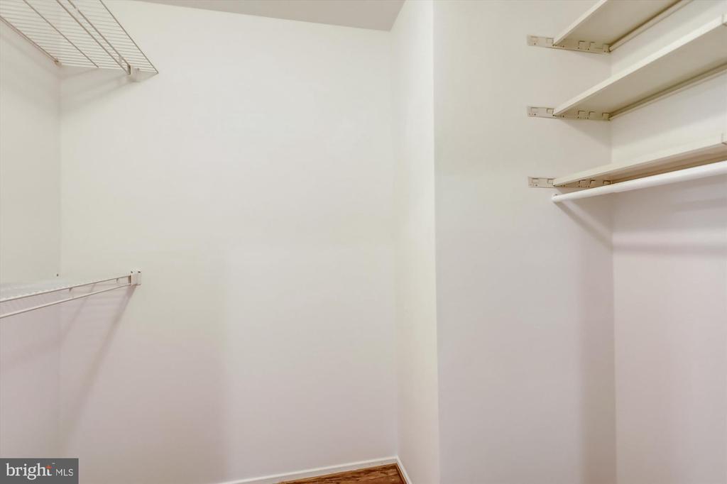 Upper Level Master Bedroom Walk-in Closet - 6604 PERSIMMON TREE RD, BETHESDA