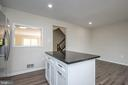Island in kitchen - 14090 RED RIVER DR, CENTREVILLE