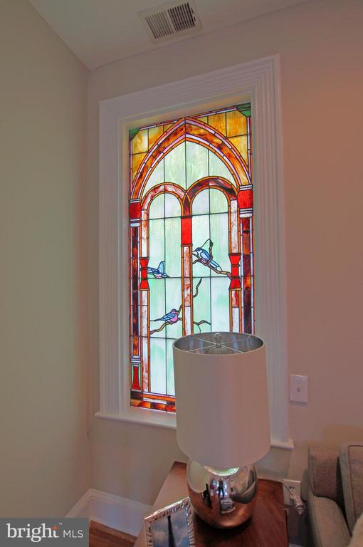 Three stained glass panels adorn the home - 719 NORTH CAROLINA AVE SE, WASHINGTON