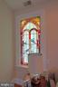 Three stained glass panels adorn the home - 719 NORTH CAROLINA AVE SE, WASHINGTON