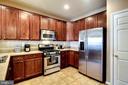 Kitchen with Stainless Steel Appliances & Pantry - 7109 SILVERLEAF OAK RD #164, ELKRIDGE