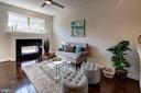 Main level family room with dual-sided fireplace - 116 WATERLINE CT, ANNAPOLIS