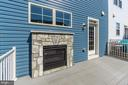 Dual-sided gas fireplace with stone surround - 116 WATERLINE CT, ANNAPOLIS