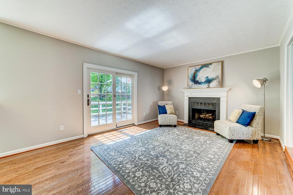 Family room is anchored by wood burning fireplace - 1331 STOKLEY WAY, VIENNA