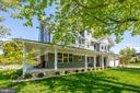 Landscape view w/ wraparound porch - 5606 FOREST PL, BETHESDA