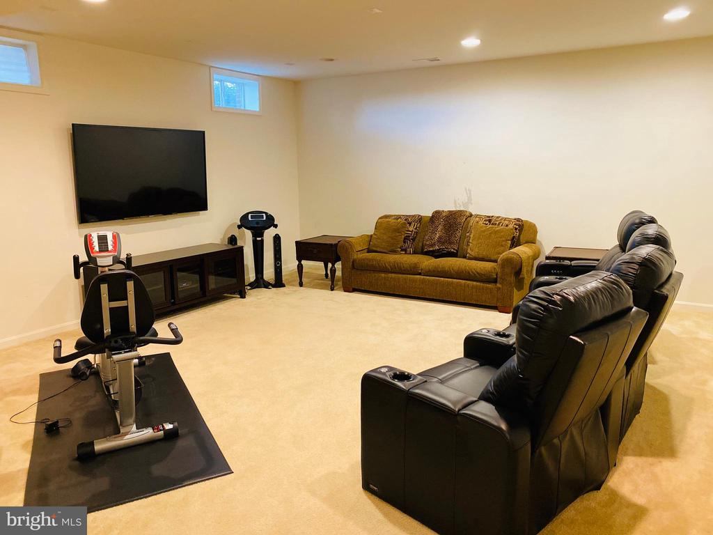 Expansive Media room in lower level. - 42426 IBEX DRIVE, STERLING