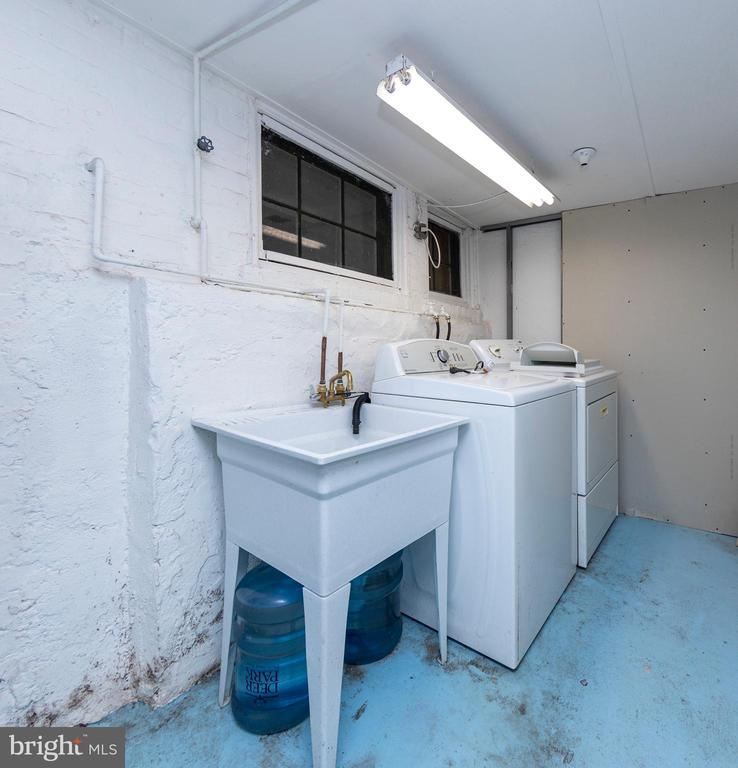 Separate space for laundry room in basement. - 2316 2ND ST NE, WASHINGTON