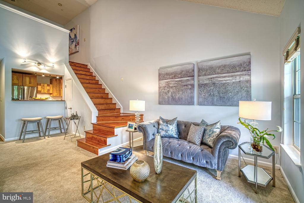 Gleaming Hardwood stair way leading to the loft - 1720 LAKE SHORE CREST DR #34, RESTON