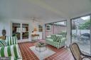 Sunroom: exit to brick patio in backyard - 5824 BRADLEY BLVD, BETHESDA