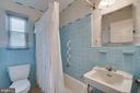 Main level full bath with tub and vintage tiles - 5824 BRADLEY BLVD, BETHESDA