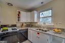 Kitchen: gas cooking, new sink and faucet - 5824 BRADLEY BLVD, BETHESDA