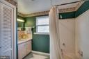 Upper level bathroom: linen closet, upgraded tiles - 5824 BRADLEY BLVD, BETHESDA